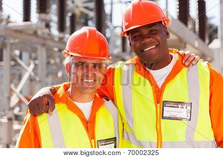 portrait of happy power company electrical co-workers