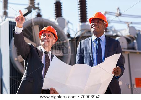 professional managers working in electrical substation