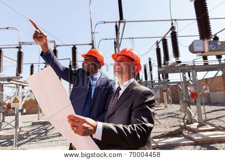 two inspectors working together in electrical substation