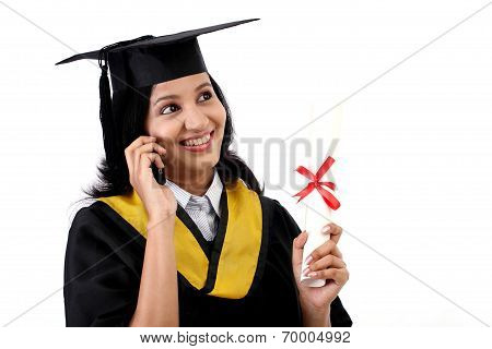 Young Graduation Female Student Talking On Mobile Phone