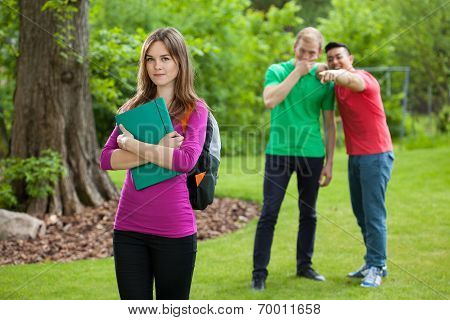 Teenage Boys Laughing Behind Girl's Back