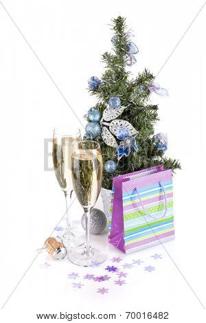 Champagne glasses, firtree and christmas decor. Isolated on white background