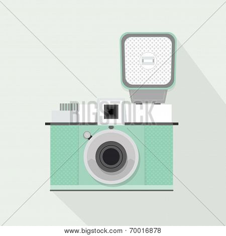 Retro light teal camera with flash and long shadow