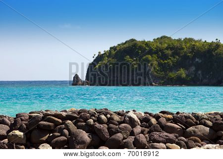 Jamaica. Stone embankment and the sea out of focus