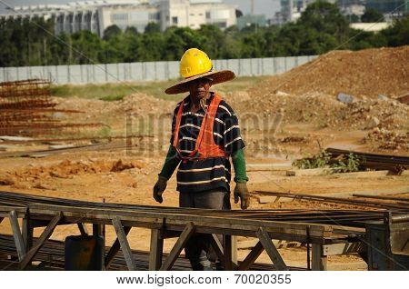 A bar binder working at binding yard in construction site