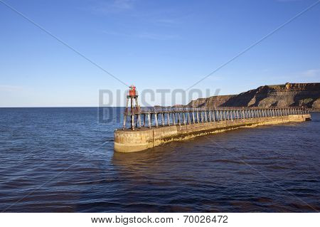 Coastal Landscape With Pier