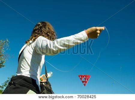 Middle Age Woman Playing With A Red Kite