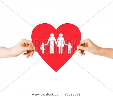 health, love, adoption and relationships concept - closeup of couple hands with big red heart with family and kids