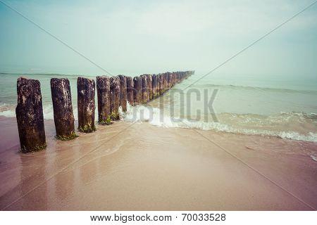 Wooden Groynes At The Beach Of Baltic Sea, Poland.