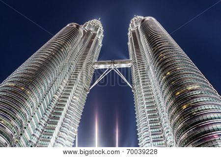 KUALA LUMPUR, MALAYSIA - JUNE 14: Petronas Twin Towers on June 14, 2013 in Kuala Lumpur, Malaysia. Petronas Towers are twin skyscrapers and were tallest buildings in the world until 2004