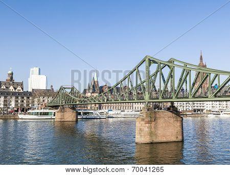 FRANKFURT, GERMANY - JULY 9, 2015: The Iron Bridge (so called Eiserner Steg) at Frankfurt Main in the afternoon