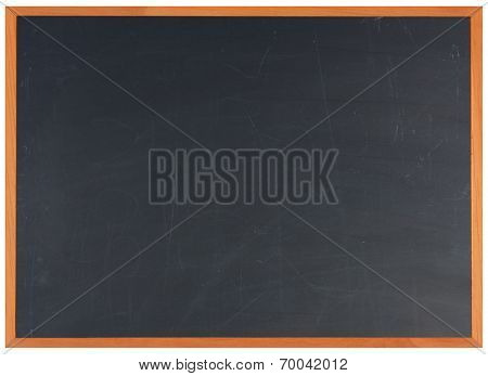 A partially erased classroom blackboard with a wood frame.
