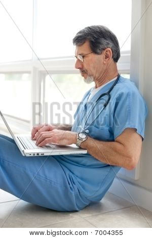 Doctor Or Nurse At Computer