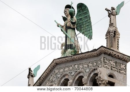 The 4 M-tall Statue Of St. Michael The Archangel On Top Of The San Michele In Foro, The Roman Cathol