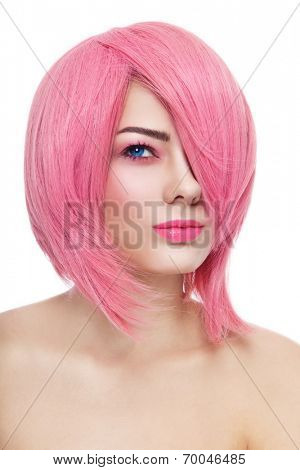 Young beautiful girl in pink cosplay wig over white background