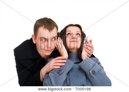 Man And Woman  Listen Headphones
