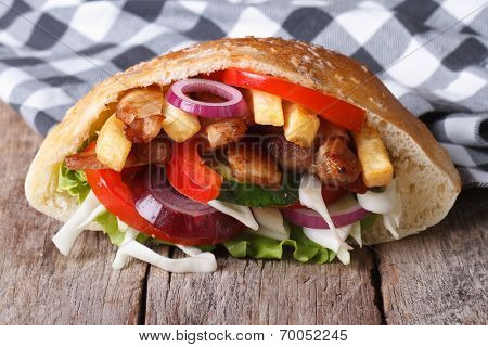 Delicious Doner Kebab With Meat, Vegetables And Fries In Pita