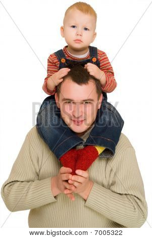 Happy Father Holding His Son On His Shoulders