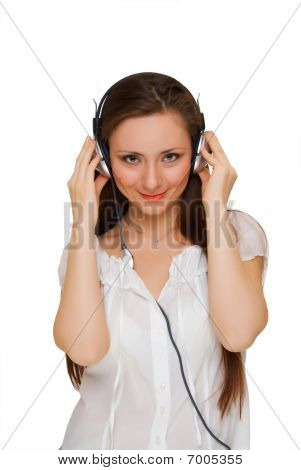 Girl In Headphones Listens To Music, Looking Straight