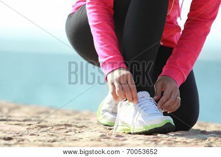 Tying Shoelaces On The Beach
