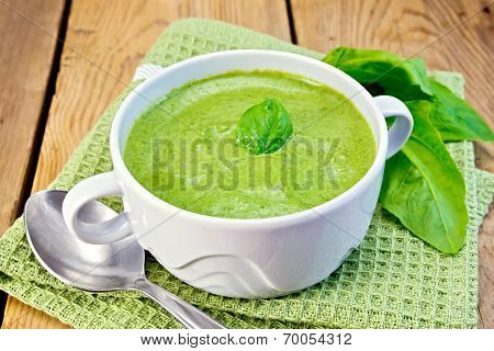 Soup Puree With Spinach Leaves On Board