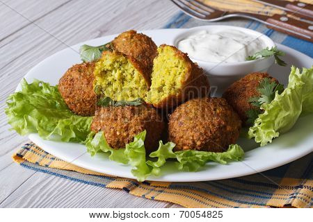 Falafel On Lettuce With Tzatziki Sauce Close-up Horizontal