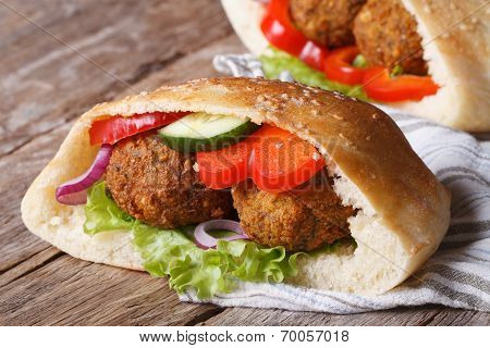 Falafel With Vegetables In Pita Bread  Closeup Horizontal
