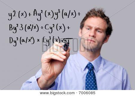 Teacher Writing A Maths Equation.