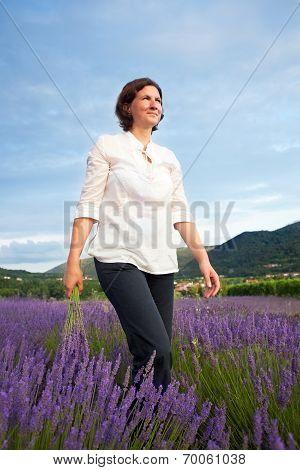 Woman Walking Through Lavender Field