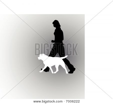 A girl with her dog on the walk