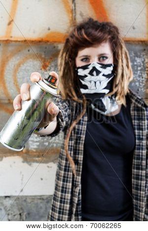 Female Hooligan Holding Graffiti Spray Can
