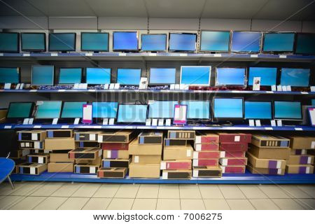 Rack with liquid crystal displays and monitors in electronics shop