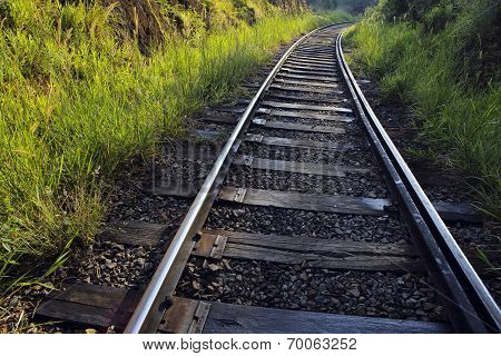 Railway train tracks through scenic countryside
