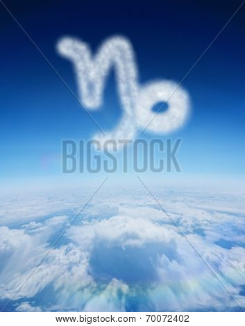 Cloud in shape of capricorn star sign against blue sky over clouds at high altitude