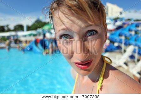 Surprised Young Woman Standing In Pool Of An Entertaining Complex