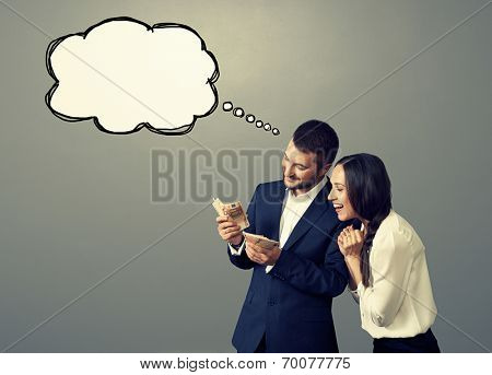 happy laughing couple looking at money over grey background with drawing empty bubble speech