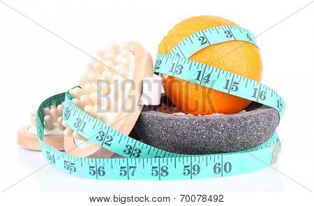 Fresh orange, tapeline, plate and a brush on white background isolated