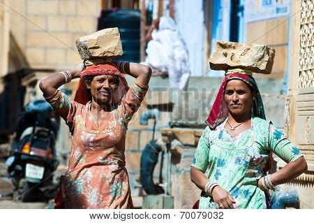 Women Carrying Bricks On A Construction Site In India
