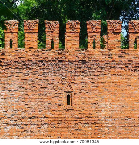 Embrasure in the defense wall of red bricks