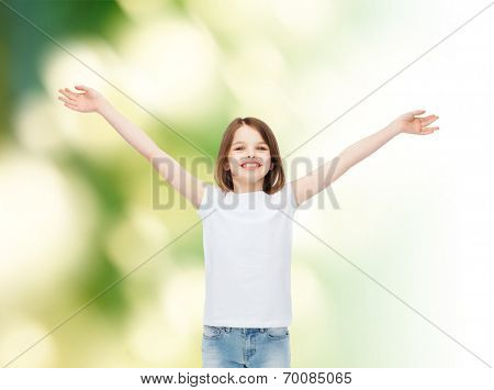 advertising, childhood, gesture, ecology and people - smiling little girl in white blank t-shirt with stretched out arms over green background