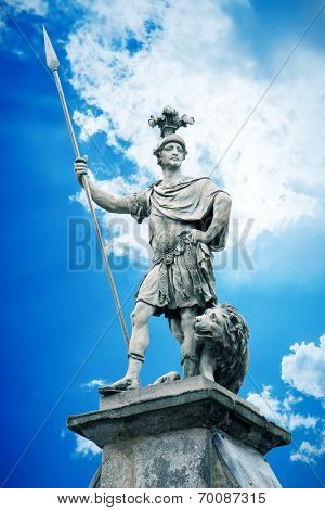 An image of a beautiful male statue with a lance