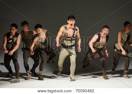 A group of six young beautiful people with maces running and screaming