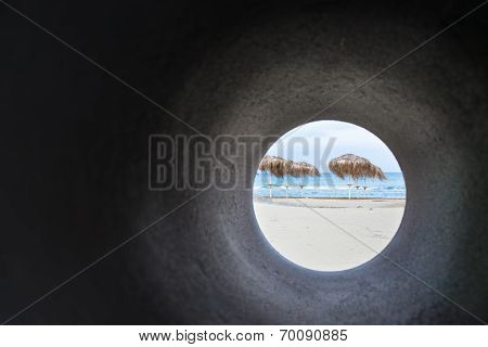 Tropical Beach Through Sewage Pipe