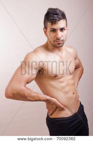 Shirtless Guy Posing In Studio Shot