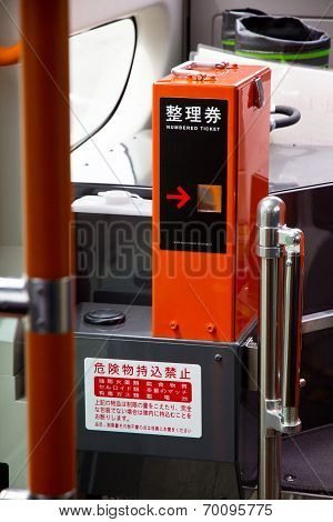 A ticket vending machine on the bus
