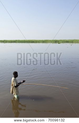 BOR, SOUTH SUDAN-DECEMBER 3 2010:Unidentified man fishes in the White Nile river of South Sudan