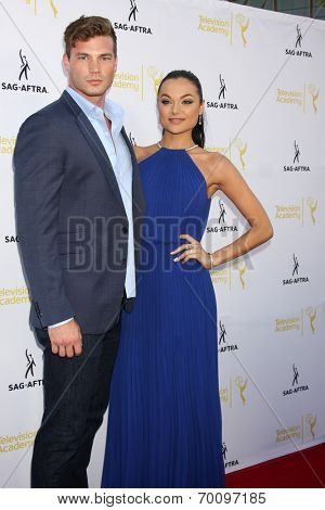 LOS ANGELES - AUG 12:  Derek Theler, Christina Ochoa at the Dynamic & Diverse:  A 66th Emmy Awards Celebration of Diversity Event at Television Academy on August 12, 2014 in North Hollywood, CA