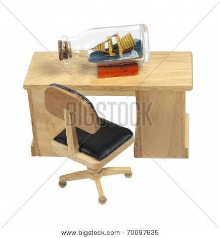 Ship In A Bottle On A Desk