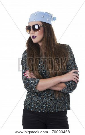 Beautiful hipster girl wearing a bandana and sunglasses