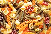 foto of flavor  - Background of Different Fancy Flavored Pasta Shapes - JPG